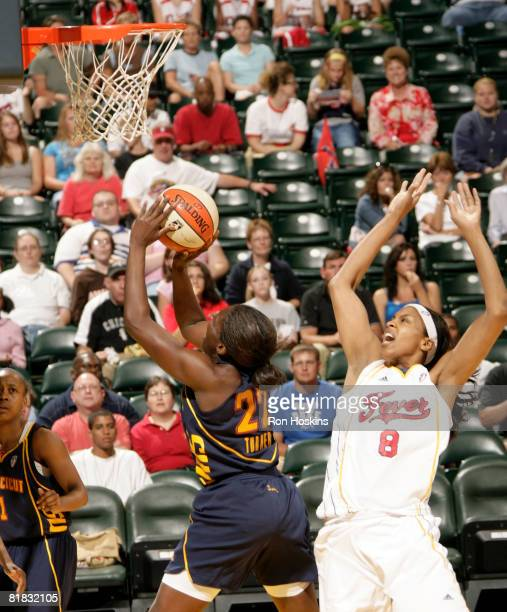 Barbara Turner of the Connecticut Sun shoots over Tammy SuttonBrown of the Indiana Fever at Conseco Fieldhouse on July 5 2008 in Indianapolis Indiana...