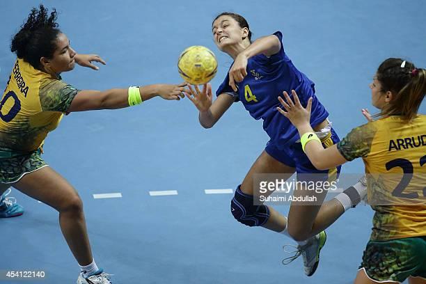 Barbara Vasconcelos Ferreira and Caroline Rodgrigues Arruda of Brazil challenge Albana Arifi of Sweden in the Women's Bronze Medal Handball Match...