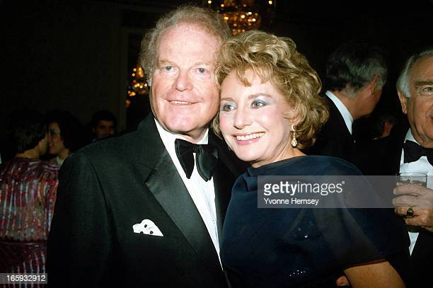 Barbara Walters and Roone Arledge pose for a photograph at Arledge's birthday celebration March 9 1983 in New York City