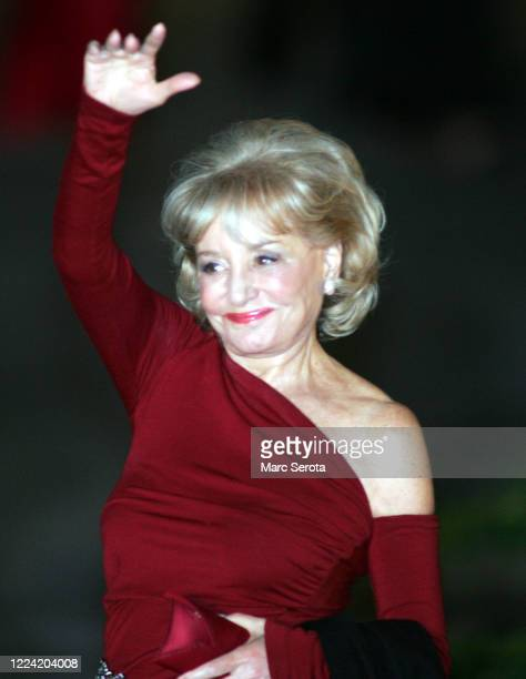 Barbara Walters waves as she arrives at the Bethesda-by-the-Sea Episcopal Church for the wedding of Donald Trump to Slovenian model Melanai Knauss in...