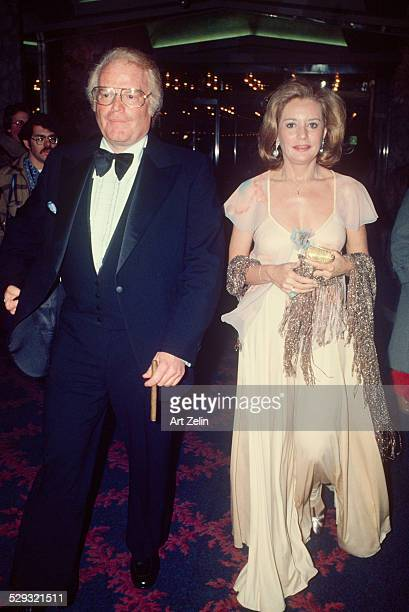 Barbara Walters wearing pink with Roone Arledge at a formal event circa 1970 New York
