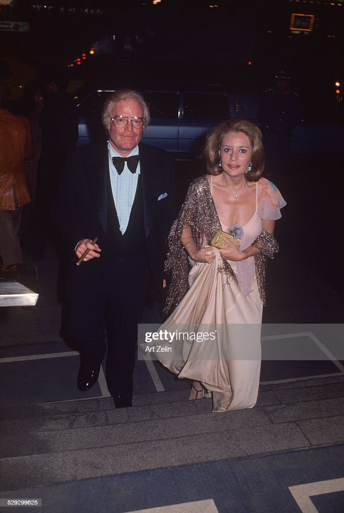 Barbara Walters with Roone Arledge going to their engagement party; circa 1970; New York.