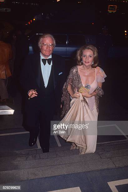 Barbara Walters with Roone Arledge going to their engagement party circa 1970 New York