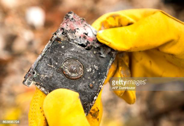 Barbara Wilson Nichols finds a burnt hard drive as she searches through the remains of her home in the Coffey Park area of Santa Rosa California on...
