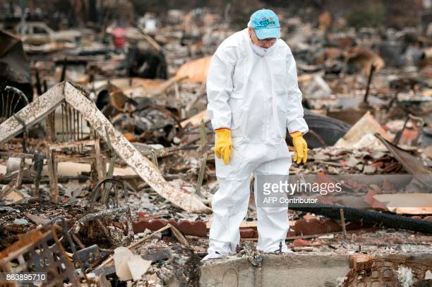Barbara Wilson Nichols searches through the remains of her burned home in the Coffey Park area of Santa Rosa California on October 20 2017 Residents...