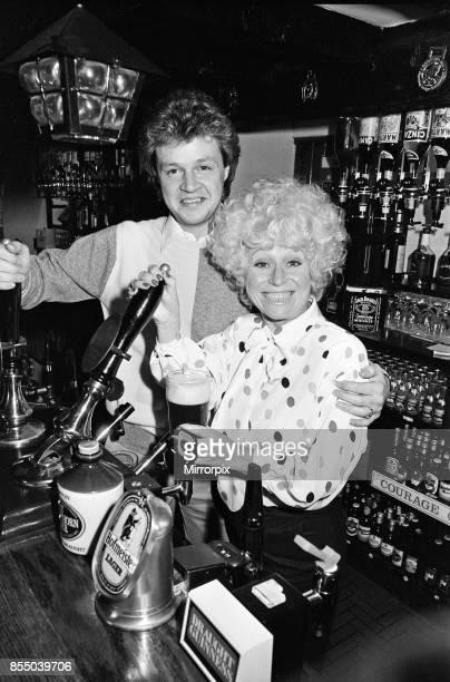 Barbara Windsor and her boyfriend Steve Hollings celebrate in their new pub, the Plough at Amersham, 12th November 1985.