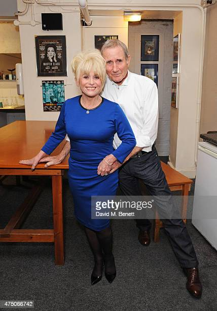 Barbara Windsor and Jim Dale pose backstage following the press night performance of 'Just Jim Dale' at Vaudeville Theatre on May 28 2015 in London...