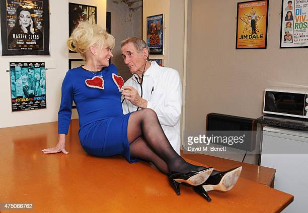 Barbara Windsor and Jim Dale recreate a famous scene from their 1969 film 'Carry On Again Doctor' backstage following the press night performance of...