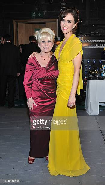 Barbara Windsor and Katherine Kelly pose in the Olivier Awards 2012 press room at The Royal Opera House on April 15 2012 in London England