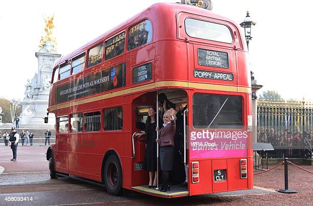 Barbara Windsor and Lacey Turner stand in the poppy bus after meeting supporters of the Royal British Legion's London Poppy Day appeal at Buckingham...