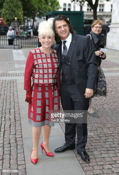 Barbara Windsor and Scott Mitchell attend a memorial service for comedian Ronnie Corbett at Westminster Abbey on June 7 2017 in London England...
