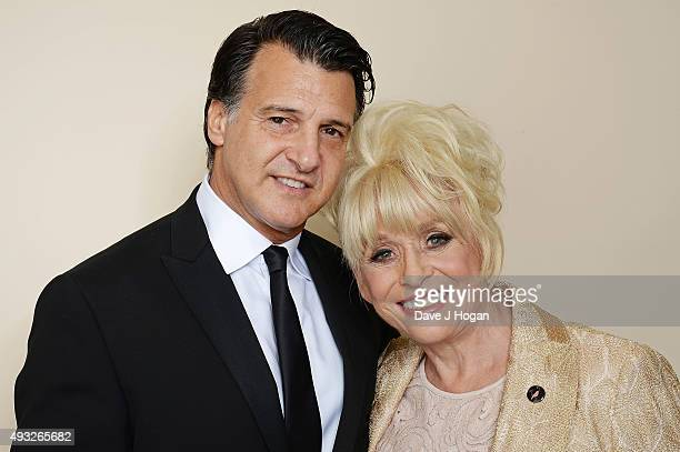 Barbara Windsor and Scott Mitchell attend the Amy Winehouse Foundation Gala at The Savoy Hotel on October 15 2015 in London England