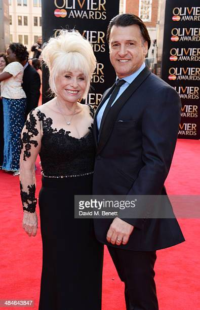 Barbara Windsor and Scott Mitchell attend the Laurence Olivier Awards at The Royal Opera House on April 13 2014 in London England