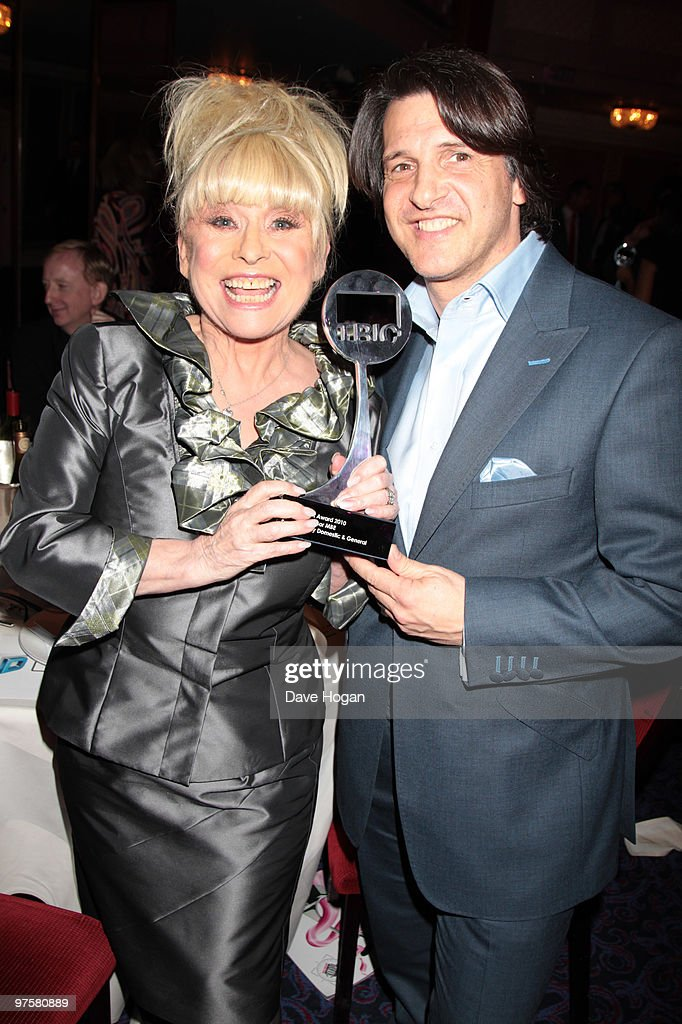 L-R Barbara Windsor and Scott Mitchell pose in the press room at the TRIC Awards 2010 held at The Grosvenor House Hotel on March 9, 2010 in London, England.