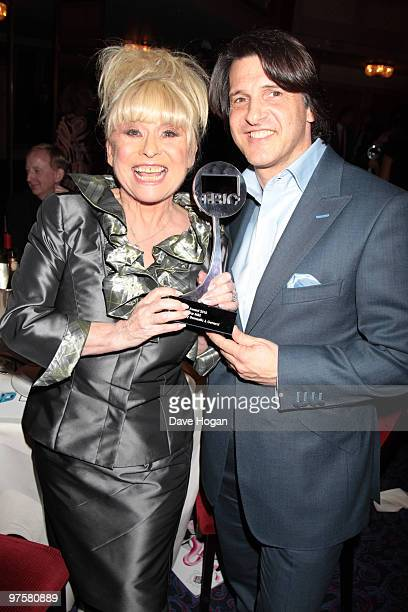 Barbara Windsor and Scott Mitchell pose in the press room at the TRIC Awards 2010 held at The Grosvenor House Hotel on March 9 2010 in London England