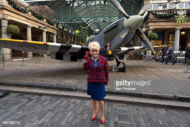 Barbara Windsor poses with a poppy at the launch of the British Royal Legion's London Poppy Day on October 29 2015 in London England Poppies have...