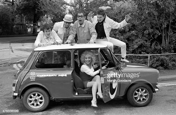 Barbara Windsor poses with in a Mini Cooper with Acid Jazz group Corduroy at a photo shoot to promote their single 'Mini' outside Hammersmith Odeon...