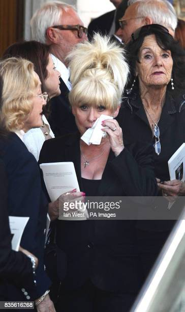 Barbara Windsor wipes her eye as she leaves the funeral of Danny La Rue at the Church of the Transfiguration in Kensal Rise London