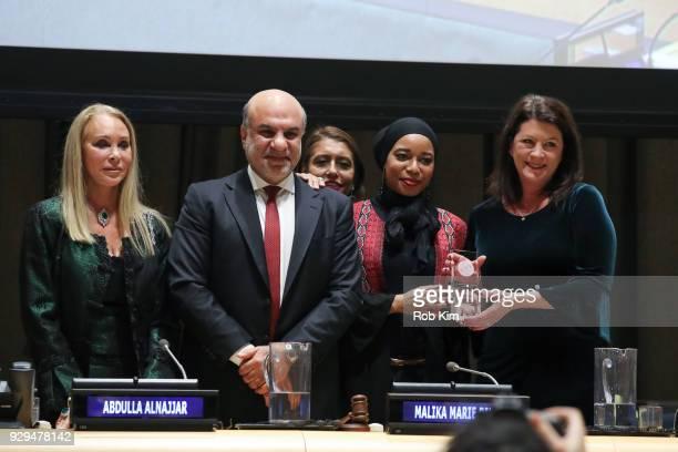 Barbara Winston Abdulla Alnajjar Muna Rihani AlNasser Malika Marie Bilal and Patricia Anne Culhane accept an award at the International Women's Day...