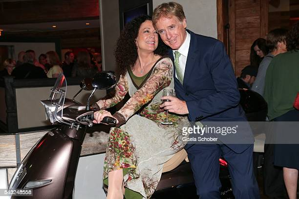 Barbara Wussow and her husband Albert Fortell on a motorcycle during the Peugeot BVC Casting Night during the Munich Film Festival 2016 at...