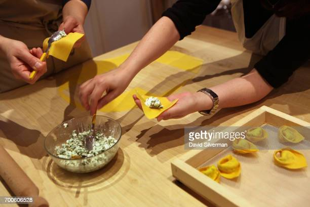 Barbara Zaccagni and visiting tourist Nava Goldstein make ricotta and parsley tortellini during a cooking lesson at Il Salotto di Penelope on March...