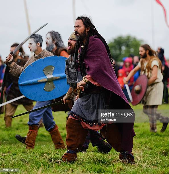 Barbarian warriors advance on Roman soldiers during a battle as the lives of Roman Legionnaires are reenacted during the Hadrian's Wall Live event at...