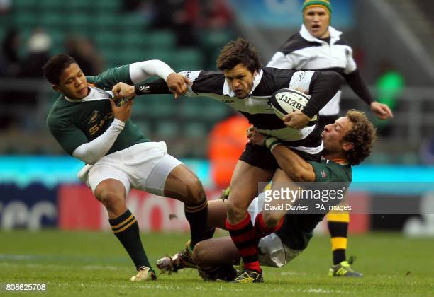 Barbarians Adam AshleyCooper is tackled by South Africa's Elton Jantjies and Andries Strauss during The MasterCard Trophy match at Twickenham Stadium...