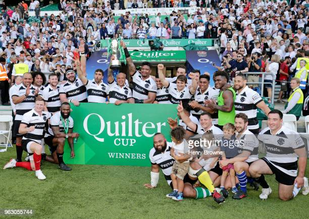Barbarians celebrate after winning the Quilter Cup match between England and Barbarians at Twickenham Stadium on May 27 2018 in London England