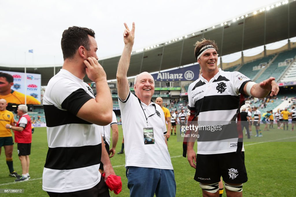 Barbarians coach Alan Jones waves to the crowd alongside Luke Jones of the Barbarians after the match between the Australian Wallabies and the Barbarians at Allianz Stadium on October 28, 2017 in Sydney, Australia.