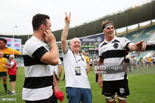 Barbarians coach Alan Jones waves to the crowd alongside Luke Jones of the Barbarians after the match between the Australian Wallabies and the...