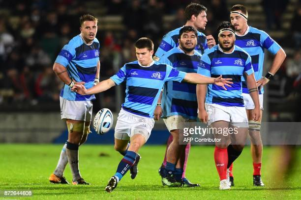 Barbarian's fullback Matthieu Jalibert kicks the ball during the rugby union match between French Barbarians and New Zealand's Maoris All Blacks on...