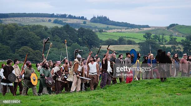 Barbarians horde face Roman soldiers from the Italian reenactment group Legio 1 Italica as they take part in a weekend of authentic events based...