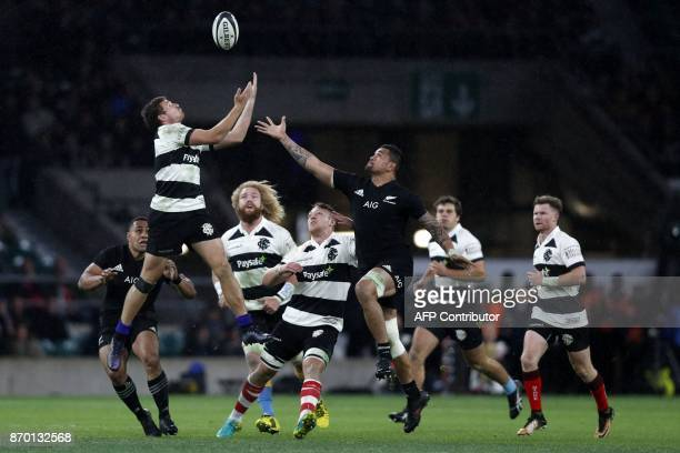 Barbarians' New Zealand fullback George Bridge and New Zealand's flanker Vaea Fifita compete for a high ball during the international rugby union...