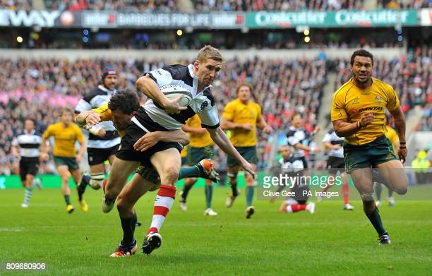 Barbarians Sam Tomkins is tackled by Australia's Adam AshleyCooper during the Killik Cup match at Twickenham Stadium London