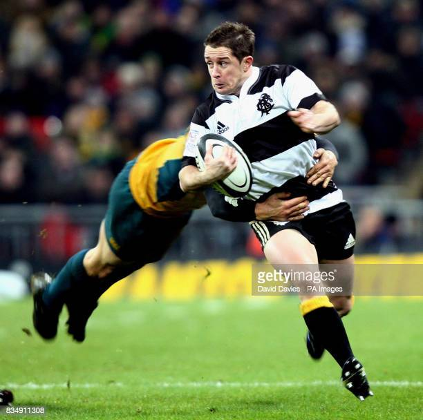 Barbarians' Shane Williams is tackled by Australia's Adam AshleyCooper during the BOA Cenetary Celebration match at Wembley Stadium London