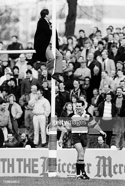 Barbarians wing David Campese smiles as a supporter finds an unusual vantage point during the match between Leicester and the Barbarians at Welford...