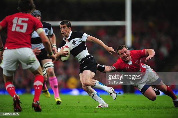 Barbarians wing Shane Williams runs past Matthew Rees during the international match between Wales and The Barbarians at Millennium Stadium on June 2...