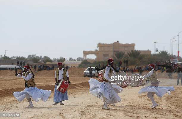 Barbaries Bedouins and Nomads of North Africa play traditional musics and preform dances during the 48th Douz Festival of Desert in Douz Tunisia on...