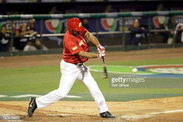 Barbaro Canizares of Team Spain hits a home run in the bottom of the eighth inning against Team France during game 2 of the Qualifying Round of the...