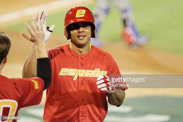 Barbaro Canizares of Team Spain is greeted in the dugout after hitting a home run in the bottom of the eighth inning against Team France during game...