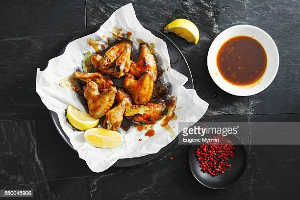 Barbecue chicken wings with orange and maple sauce