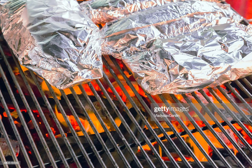 Barbecue Grill cooking food in aluminum : Stock Photo