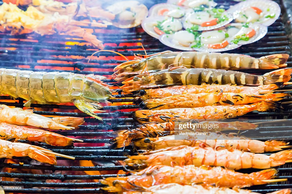 Barbecue Grill cooking seafood. shrimps : Stock Photo
