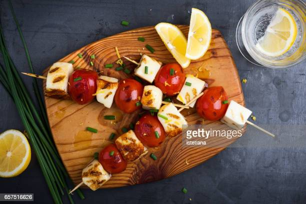 Barbecue haloumi and cherry tomato skewers with lemon zest