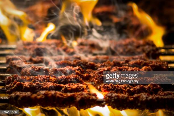 barbecue kebabs on a hot grill - chicken masala stock photos and pictures