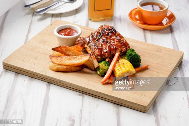 barbecue pork ribs - sparerib stock photos and pictures