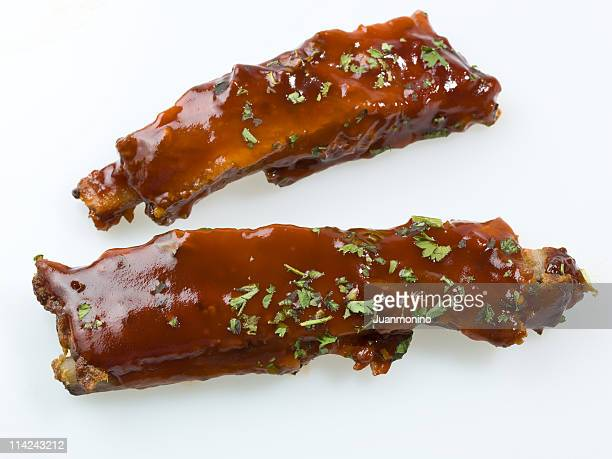 barbecue ribs on white background from above - barbeque sauce stock photos and pictures