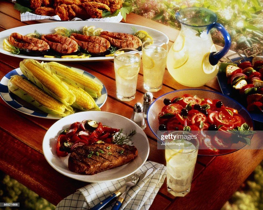 Barbecue spread on picnic table : Stock Photo