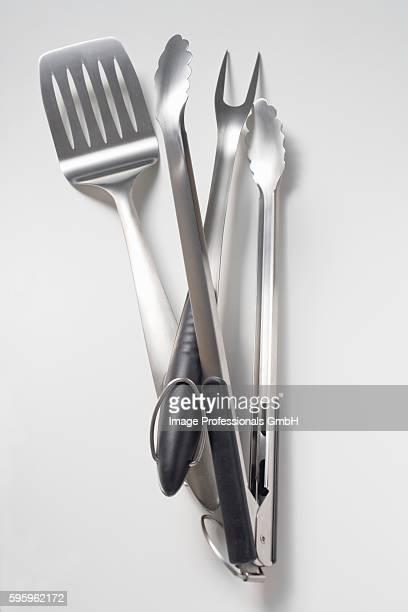 Barbecue tools (tongs, carving fork, spatula)