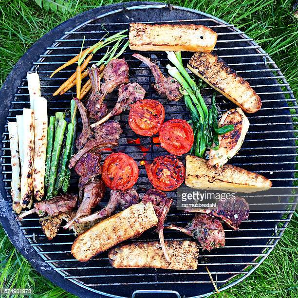 Barbecue with meat, vegetables and bread